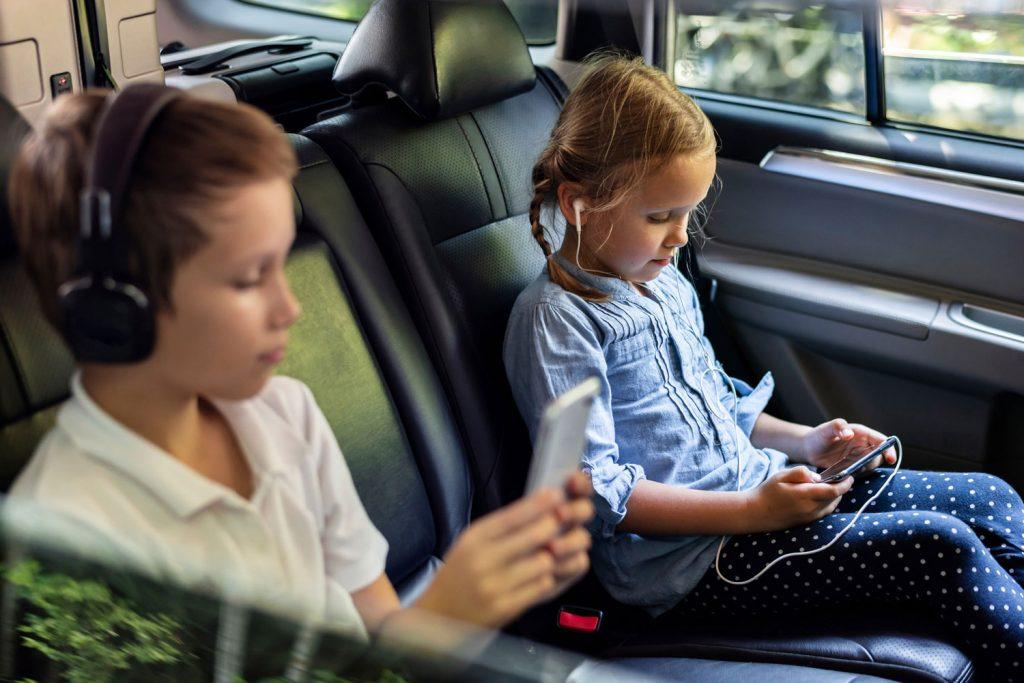 Children using phones to watch games